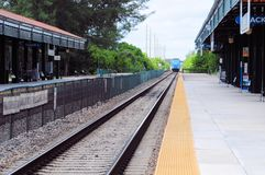 Passenger train  leaves station. Perspective view of train departing from the station. Photographed in South Florida Stock Images