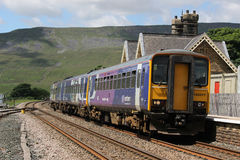 Passenger train leaving Ribblehead station Royalty Free Stock Photos