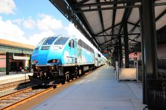 Passenger train leaving station in Florida Royalty Free Stock Images