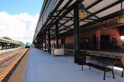 Passenger train leaving station Royalty Free Stock Photography