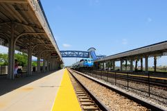 Passenger train leaving station in South Florida Royalty Free Stock Photos