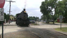 Passenger train leaving the station (2 of 3). A view or scene of Transportion stock footage