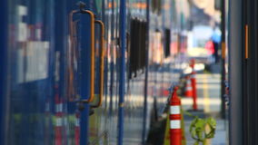Passenger Train Leaving. V1. Passenger train leaving station. Shallow depth of field stock footage