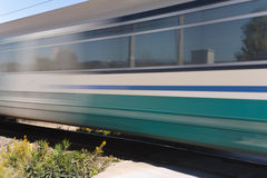 Passenger train in motion Stock Photos