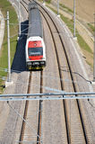 Passenger train in motion on electric railway, above view Stock Photos