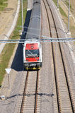Passenger train in motion on electric railway, above view Royalty Free Stock Photos