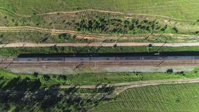 The passenger train moves along the rails on the left to the right. Shooting from the top point stock video footage
