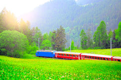 Passenger train moves from Davos to Chur. Stock Images