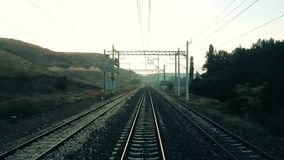 Passenger train moving slowly on the railroad. After a break in the morning, view from the rear of train stock footage