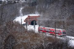 Passenger train moving towards the tunnel. January, 2017: Lithuanian Railways` train moving towards the tunnel on its way from Kaunas to Vilnius. Winter scene royalty free stock photo