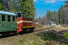 Passenger train on old narrow-gauge railway. Royalty Free Stock Photo