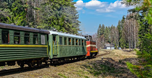 Passenger train on old narrow-gauge railway. Royalty Free Stock Image