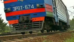 Passenger train passes by the camera stock video