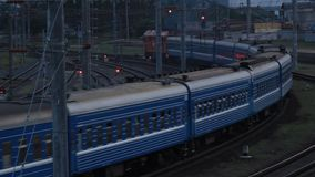 The passenger train passes a turn on the railway.  stock video footage