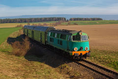 Passenger train passing through countryside Royalty Free Stock Photos