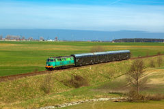 Passenger train passing through countryside Royalty Free Stock Images