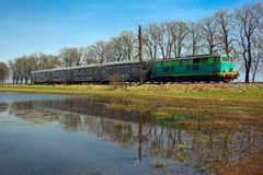Passenger train passing through countryside Royalty Free Stock Image