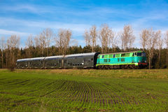 Passenger train passing through countryside Stock Photo