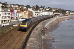 Passenger train passing Dawlish a seaside town in Devon England UK Royalty Free Stock Photography