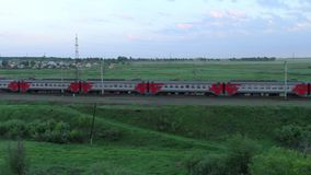 Passenger train passing through the fields in the countryside. Trans-Siberian Railway stock video