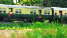Passenger train passing from India. Passenger train passing at nature background stock video