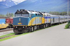 Passenger train. Passenger train from Prince George to Jasper stands on the station on June 15, 2011 in Jasper, Alberta, Canada stock images