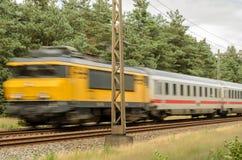 Passenger train races past Stock Photo