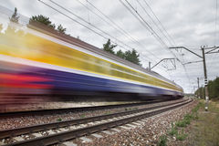Passenger train on railroad tracks in speed motion Stock Photography