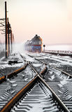 Passenger train rapidly moving along the snow Stock Photos
