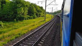 The passenger train returns to the left. The view from the window of the car, bus, train. Journey from the train on a. The view from the high-speed train on the stock video