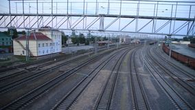 Passenger train rides the station, top view, time-laps. Diesel train stock footage