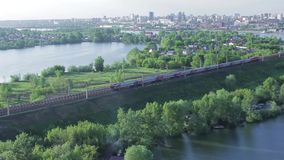 Passenger train rides into town stock footage