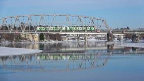 Passenger train runs on the railway bridge. Savonlinna, Finland. SAVONLINNA, FINLAND - MARCH 03, 2018: Passenger train runs on the railway bridge stock video