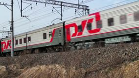 Passenger train Russian Railways. April 28, 2017 St. Petersburg, Russian Railways Passenger train stock video footage
