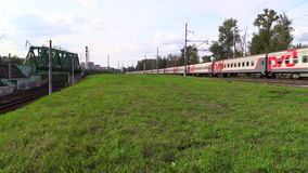 Passenger train of RZD rides at high speed. Lyubertsy, Moscow region, Russia. 6 Sep 2014. Passenger train of RZD (Russian railway) rides at high speed. Full HD stock video footage