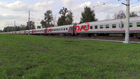 Passenger train of RZD rides at high speed. Lyubertsy, Moscow region, Russia. 6 Sep 2014. Passenger train of RZD (Russian railway) rides at high speed. Full HD stock video