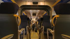 Passenger train seats. Inside modern train wagon, people. Train travel classes stock video footage