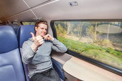 Passenger in train showing thumb up Royalty Free Stock Photography