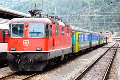 Passenger train stands on Brig station Royalty Free Stock Photos