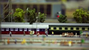 Passenger train on the station platform. Tilt film Loop ready File stock video footage