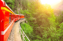 Passenger train at sunset. Royalty Free Stock Photography