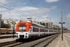 Passenger train in Tarragona, Spain Stock Photo