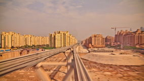 Passenger Train Time Lapse Dubai. V22. Very cool train ride time lapse through the Palm Jumeirah into media city in Dubai stock video footage