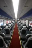 Passenger train traveling. Empty modern passenger train wagon interior stock images