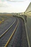 Passenger train traveling into the Arizona sunset Royalty Free Stock Photo