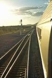 Passenger train traveling into the Arizona sunset Royalty Free Stock Photography