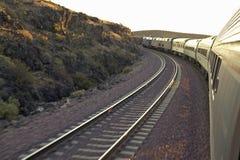 Passenger train traveling into the Arizona sunset Stock Photo