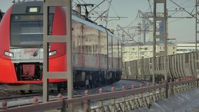 Passenger train traveling on the Moscow central ring. 4k, passenger train traveling on the Moscow central ring on the background of houses stock footage