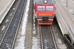 Passenger train. A passenger train is traveling by train station Stock Photo