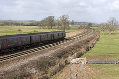 Passenger train travels south of Exeter in Devon UK Royalty Free Stock Images